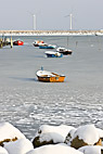 Små fiskerbåde i isen ud for Amagers kyst - Small freezing boats at the coast of Amager