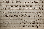 Ark med håndskrevne noder - Old yellowish sheet of handwritten music