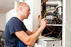 Energimontør - Heating and sanitary technician testing and adjusting a gas heater