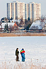 To lystfiskere på en tilfrosset sø syd for København - Two men fishing on a frozen lake in the outskirts of Copenhagen