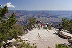 Grand Canyon - Group of Tourists enjoy the view from the South Rim of Grand Canyon